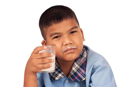 concede: happy school boy drinking milk