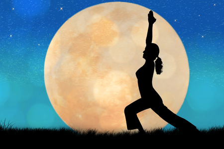 Silhouette young woman practicing yoga at full moon background