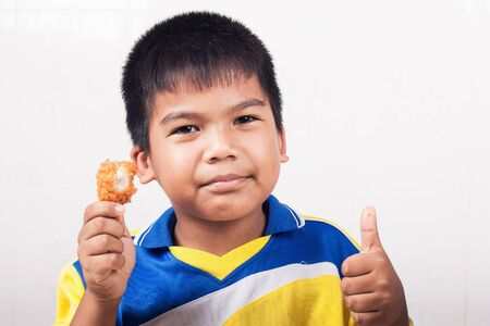 concede: little boy eating fried chicken isolate background