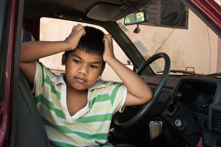 grieve: boy sad alone in the old car