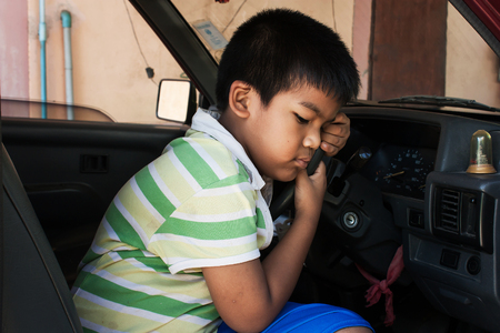 insular: boy sad alone in the old car