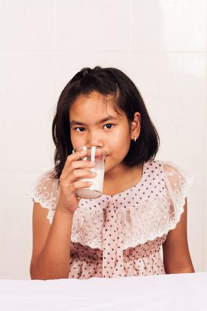 concede: cute little girl drink milk Stock Photo