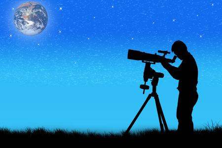 eyepiece: silhouette of young man looking through a telescope at night  background,the backdrop of the planet earth. Elements of this image furnished by NASA. Stock Photo