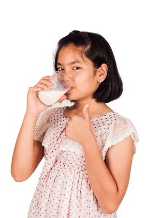 assent: cute little girl drink milk Stock Photo
