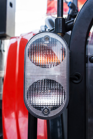 heavy equipment operator: part of headlight tractor Stock Photo