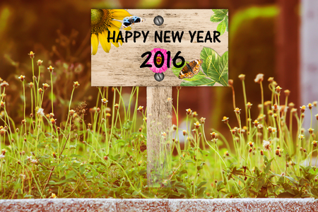 beautiful woodland: happy new year signpost in beautiful woodland with vintage floral meadow filter Stock Photo