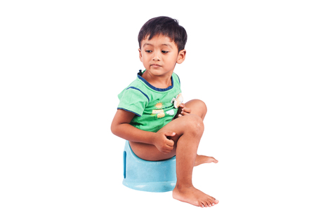 defecation: cute little boy constipation isolate background