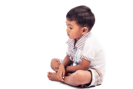 to face to face: little boy sad alone Stock Photo