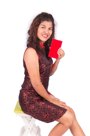 chipao: happy chinese new year, asian women holding red envelope