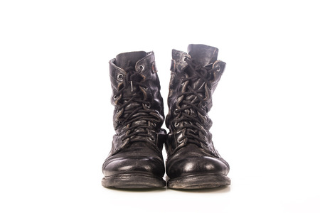 military boots: old black combat boots on white background Stock Photo