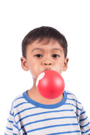 blow up: little happy boy blow up balloon Stock Photo