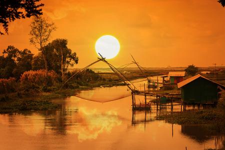 net fishing: Net Fishing Thailand in Thale Noi , Phatthalung Sunset Background