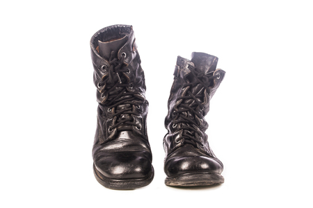combat boots: old black combat boots on white background Stock Photo