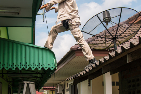 young man working  install antenna