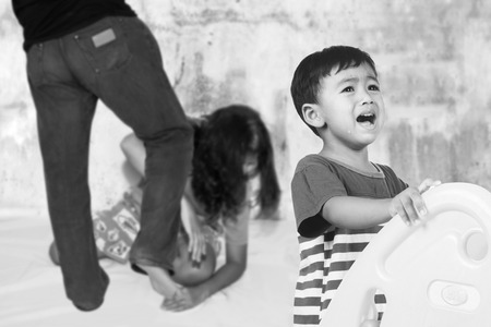 dysfunctional: family fight concept, boy crying with his parent fighting Stock Photo