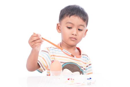 ittle: ittle boy painting easter egg Stock Photo