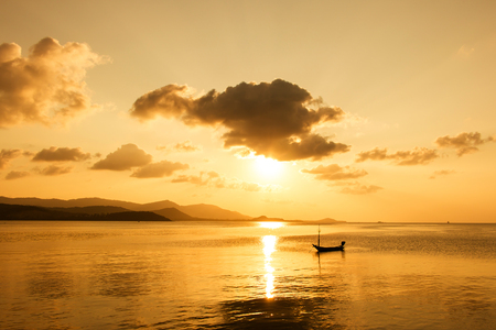 warm water fish: boat in the sea sunset background