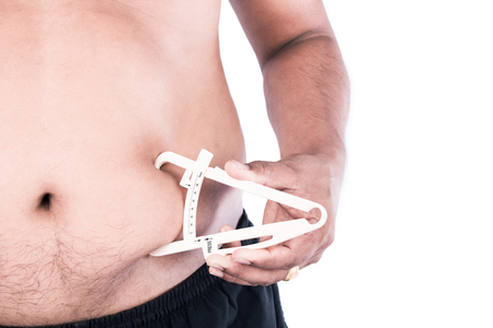 caliper: Young Man Measuring Fat Belly With Fat Caliper