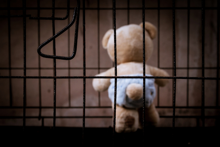 incarcerated: teddy bear abandoned in jail vintage tone