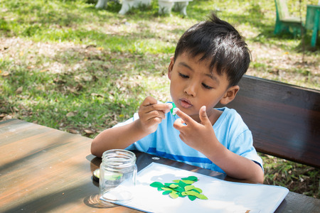 learning by doing: Little kids do homework arts in green park