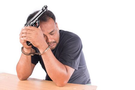 commits: Young man hand in handcuff Commit suicide black and white Stock Photo