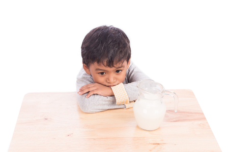 Cute little boy bored with milk