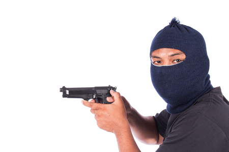 Bandit with gun in hand Stock Photo