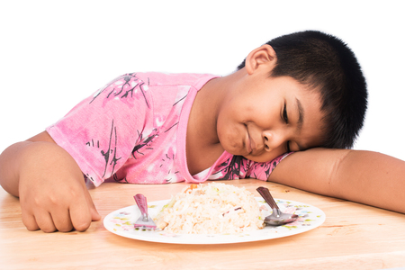 fussy: Cute little boy bored with food
