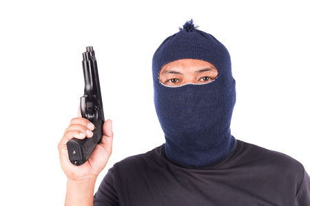 man holding gun: Young man holding gun