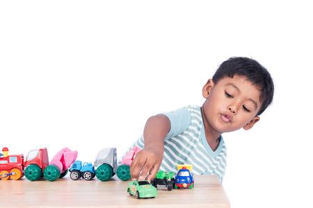 Cute little boy play toy car Stockfoto