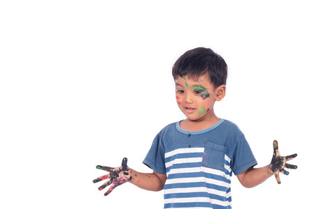 messily: Cute child asian little boy playing water color and paint on face