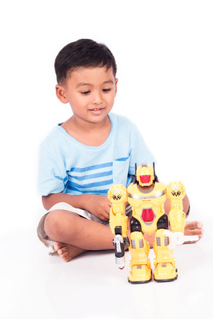 power giant: cute child asian little boy play robot fighting