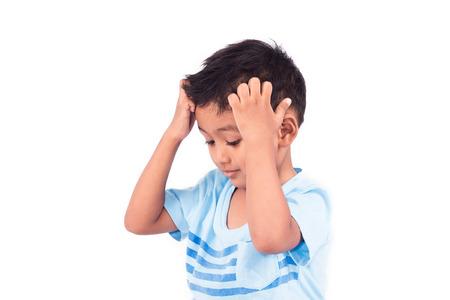 scratching: Cute child asian little boy scratching head