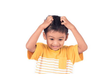 Cute childe asian little boy scratching head