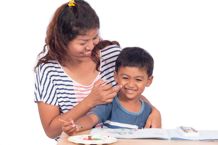 to tease: Mother tease her son while doing homework