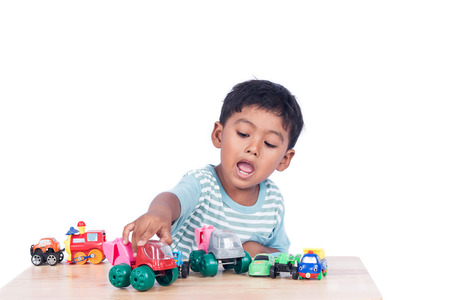 Cute little boy play toy car Stock Photo