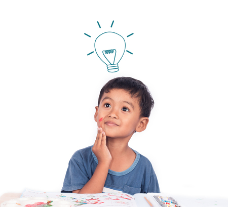 envision: Cute little boy thinking while doing homework Stock Photo