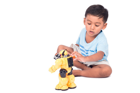 rousing: cute child asian little boy play and excited robot fighting toy