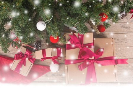 chirstmas: Brown gift box and chirstmas tree on wooden background
