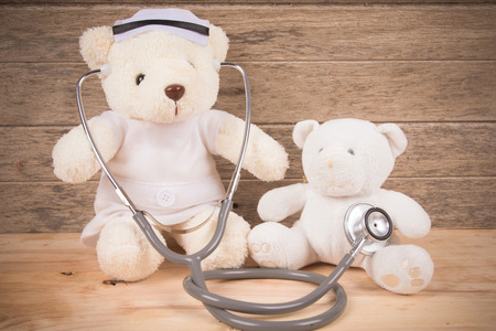 Cute White Teddy bear wear nurse use stehoscope check health bear baby
