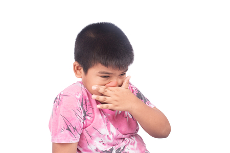 Asian little boy itchy on his nose Stock Photo