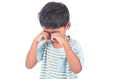 Cute asian little boy sad and cry on white background Stock Photo