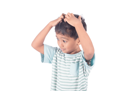 cute asian little boy scratching on head on white background Stock Photo