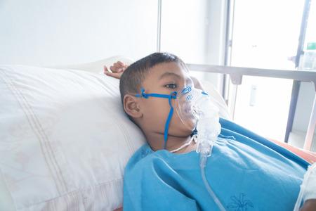 Little asian boy sick asthma Stock Photo