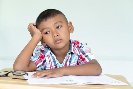 Cute little boy do not do homework Stok Fotoğraf
