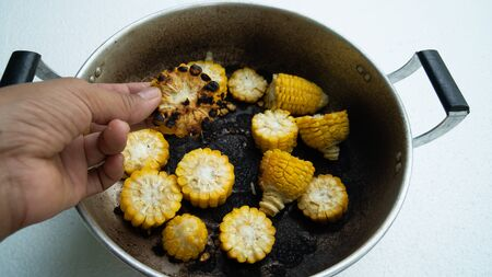 burned-out corn in  pot Stock Photo