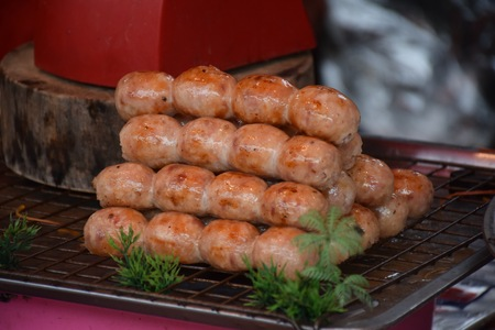 Thai Sausages Grilled until cooked placed in a tray and sold to customers in the Thai market, thai local food