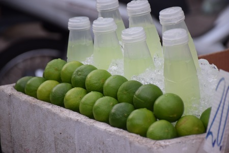 Fresh lime juice sold in street shops at Khaosan Road or Thanon Khaosan is a popular tourist street in central Bangkok, thailand Banco de Imagens