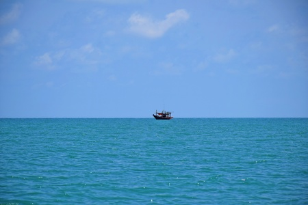 Small boat floating in the middle of the sea, Boat in the South of Thailand
