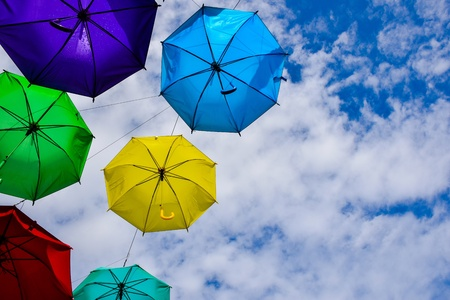 Colorful umbrellas in the blue sky, bright colors of the summer.